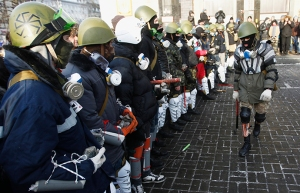 """Anti-government protesters from far-right group """"Right Sector"""" train in Independence Square in central Kiev"""